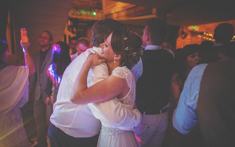 The bride embraces her father on the dancefloor at Almonry Barn