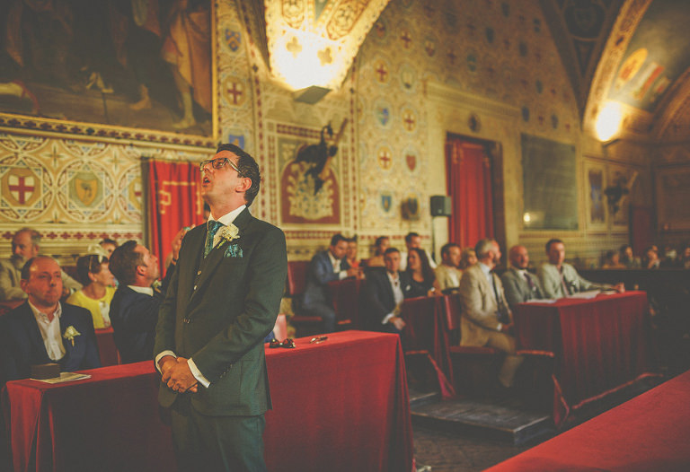 The groom looks up to the ceiling and waits nervously