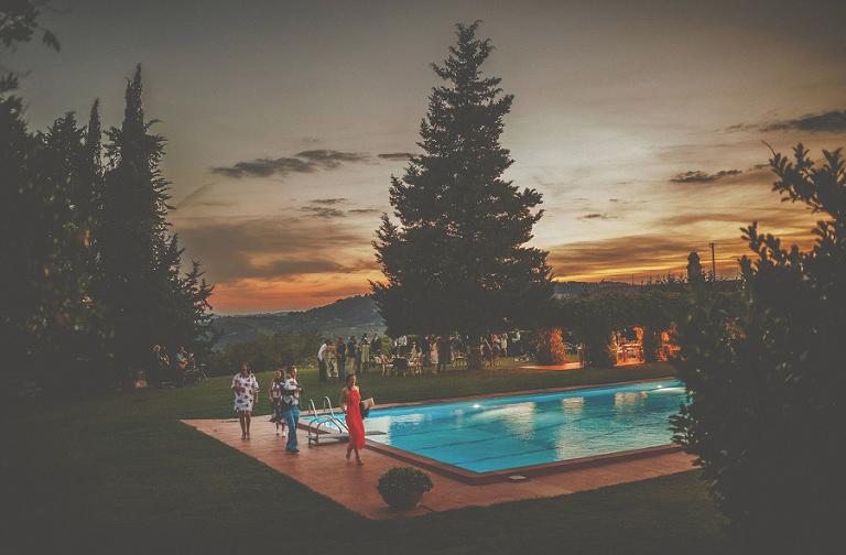 Guests walk passedf the swimming pool at Villa di Ulignano