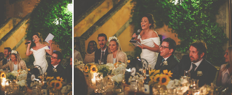 The bride stands at the top table and delivers her speech