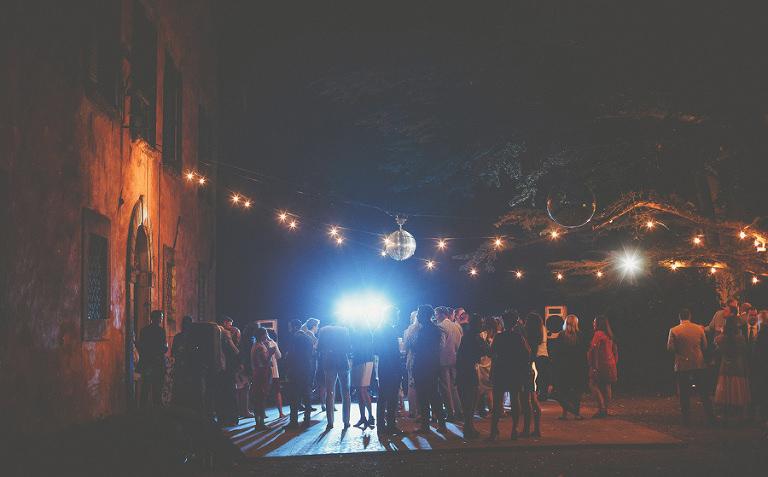 Guests congregate around the dancefloor