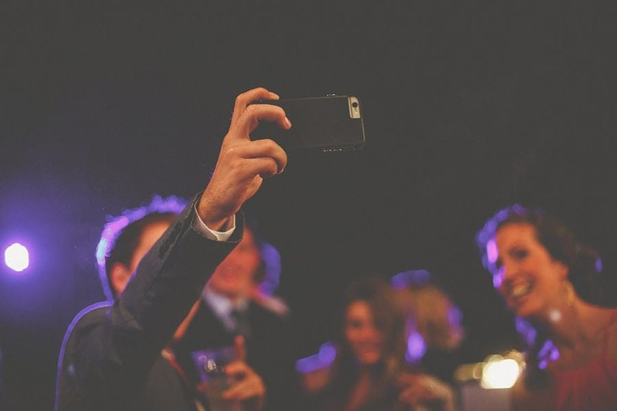 A guest takes a photograph of everyone on his mobile phone