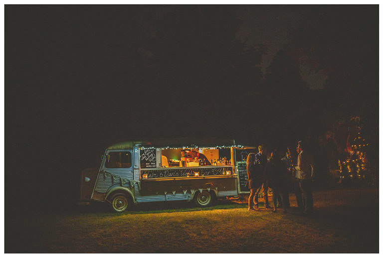 A cocktail van serves drinks to wedding guests in a field in the Frome countryside