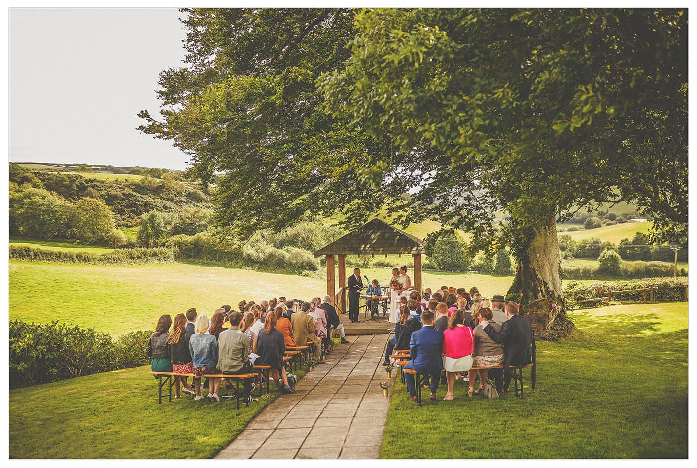An outdoor wedding ceremony in the countryside