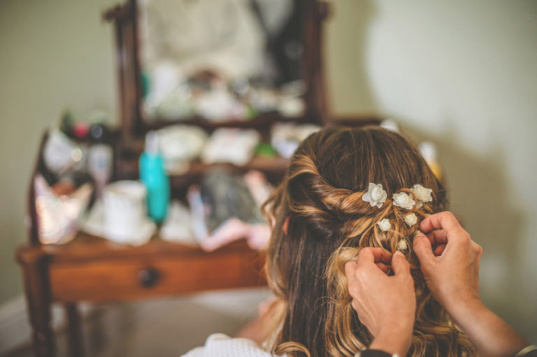 The brides flowers are plaved into her hair