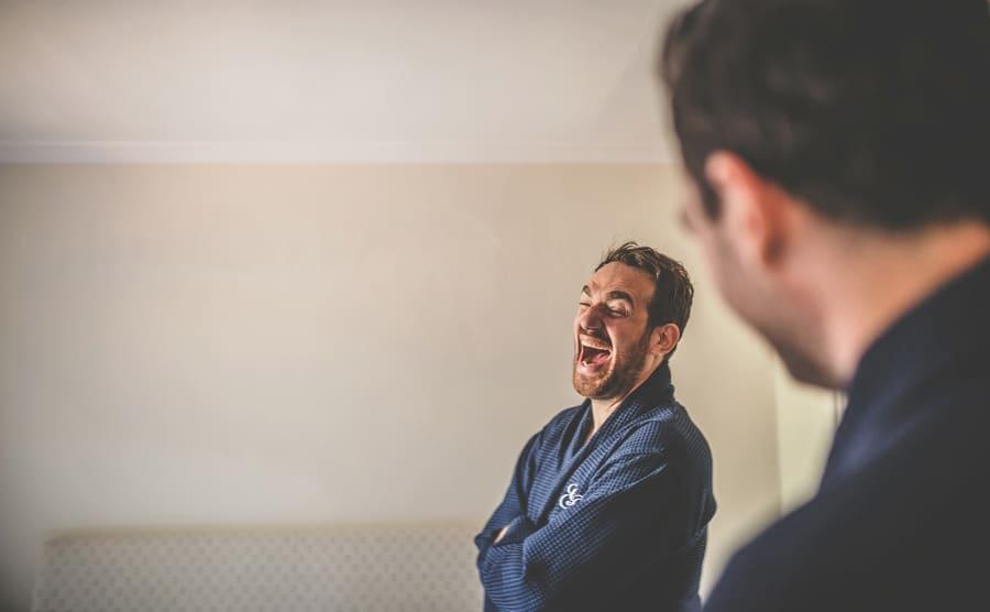 The best man laughs at a joke
