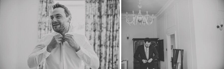 The groom puts on his shirt at Pennard house, Somerset