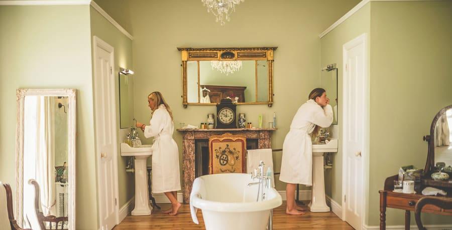 Bridesmaids getting ready at Pennard house, Somerset