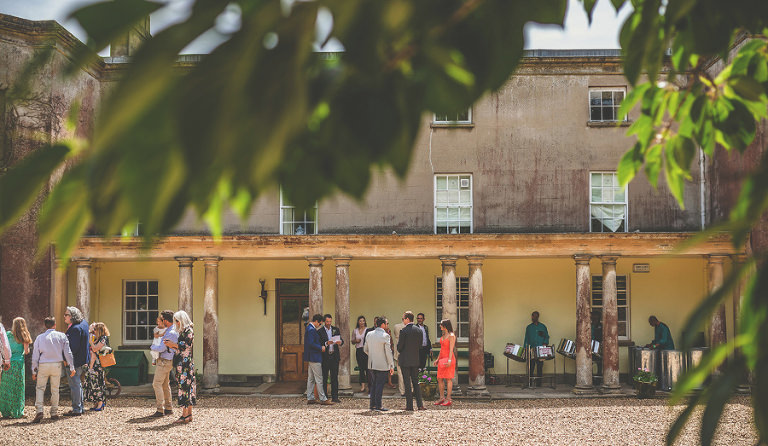 Guests gather outside at Pennard house, Somerset