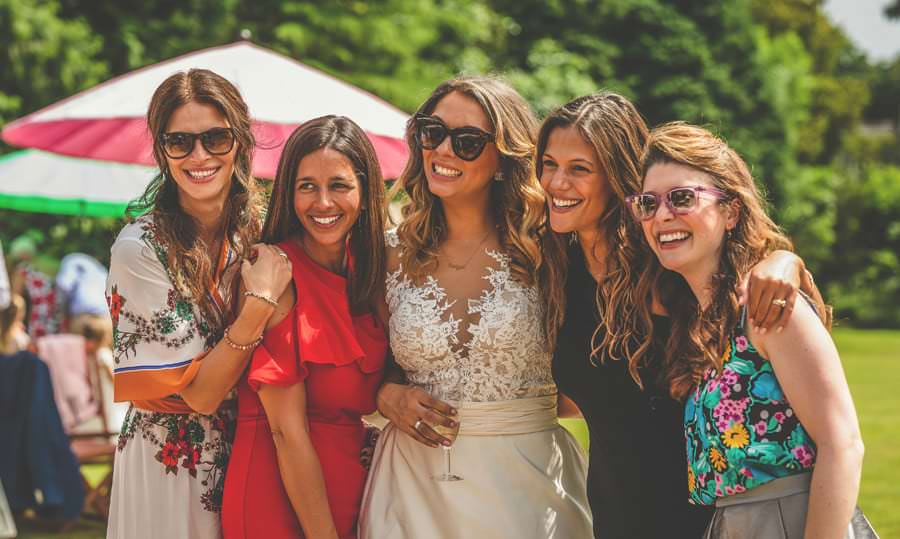 The bride and the bridesmaids on the lawn at Pennard house, Somerset