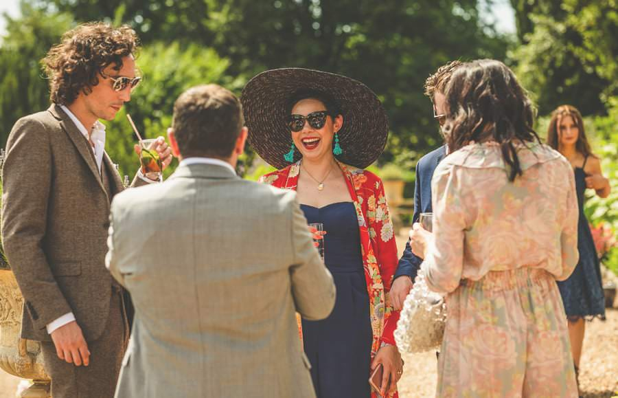Wedding guests chat to each other on the lawn at Pennard house, Somerset