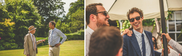 Wedding guests chatting on the lawn at Pennard house, Somerset