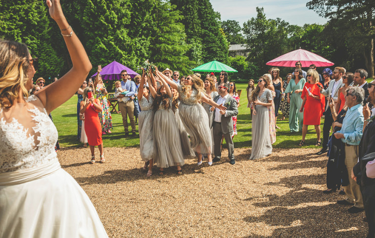 The bridesmaids catching the bouquet at Pennard house, Somerset