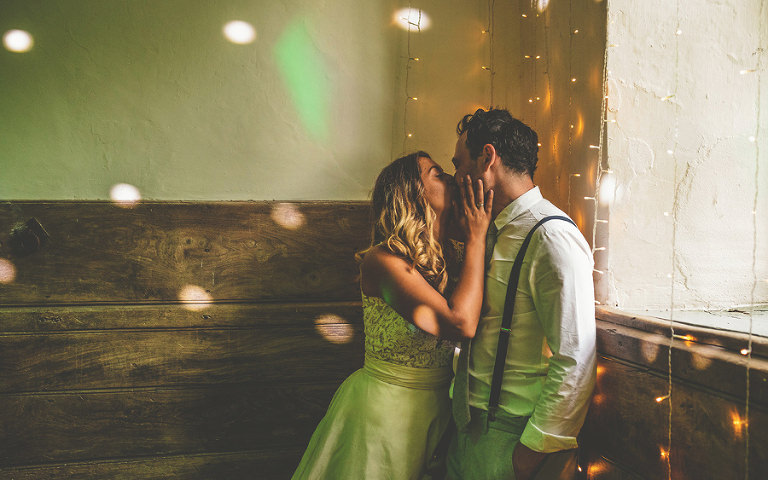The bride and groom kiss on the dancefloor at Pennard house, Somerset