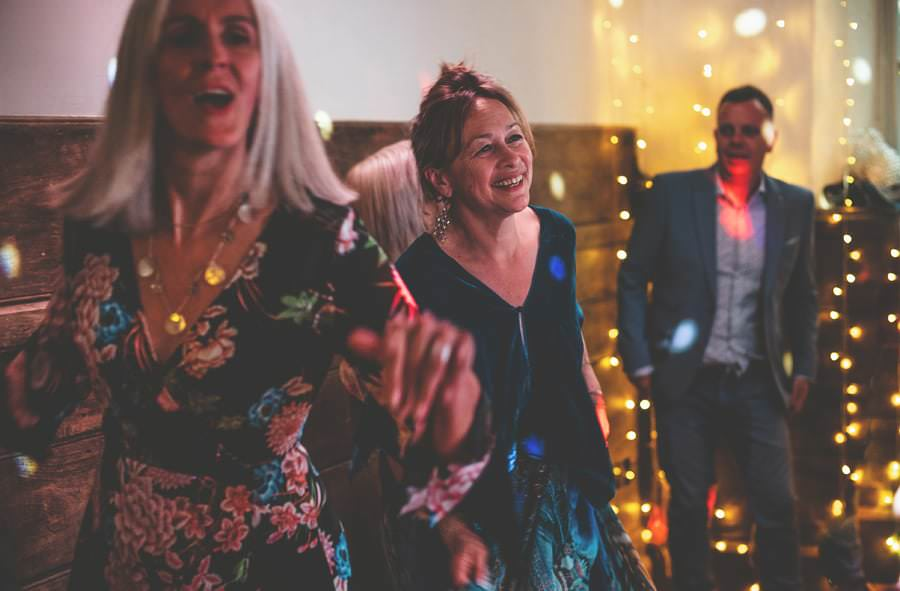 A lady laughs on the dancefloor