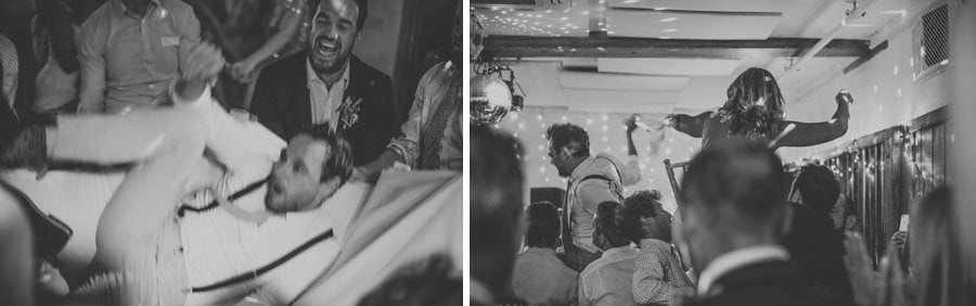 The groom is tossed up and down and the bride is lifted into the air on a stool