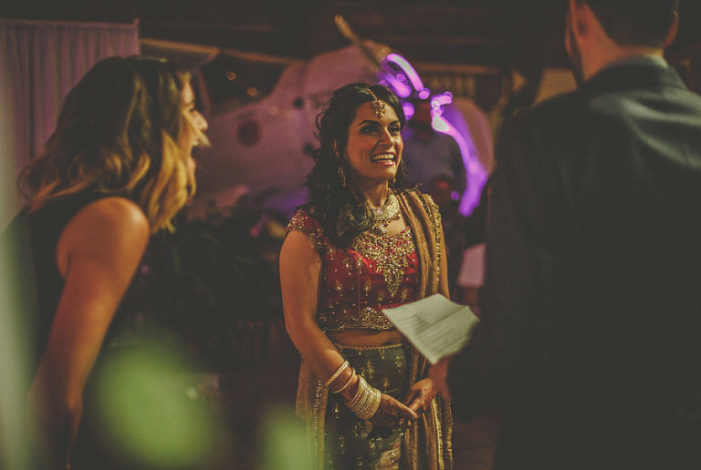 The bride laughs during the wedding ceremony