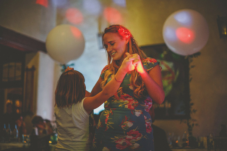 A wedding guest dances with her daughter at Voewood, Norfolk