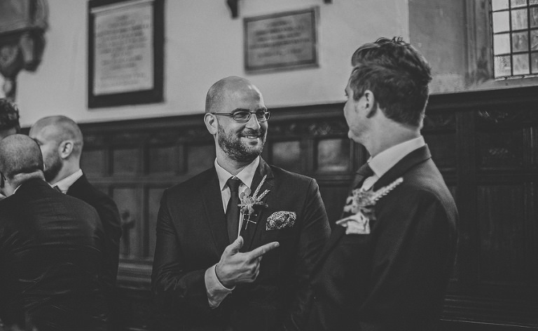 An usher shares a joke with a friend in the church