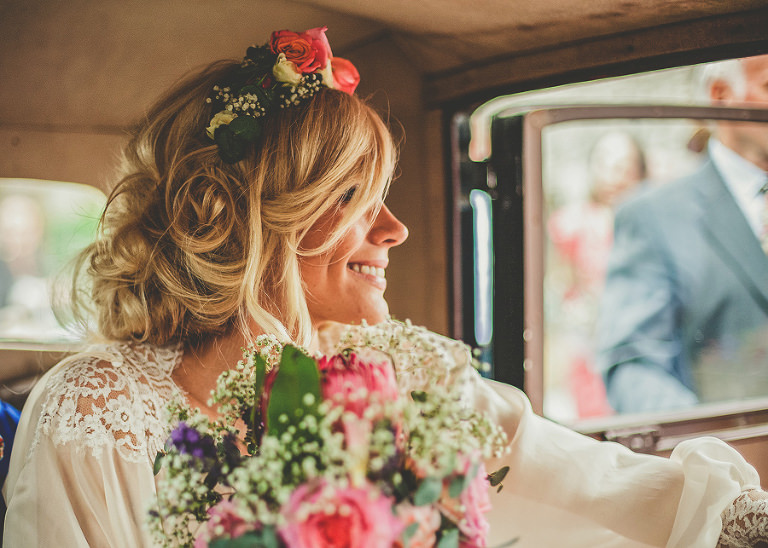 The bride gets ready to leave the Church of St Michael and All Angels, Somerton