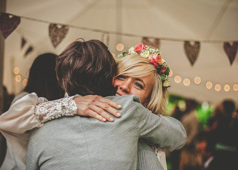 The bride embraces an old friend
