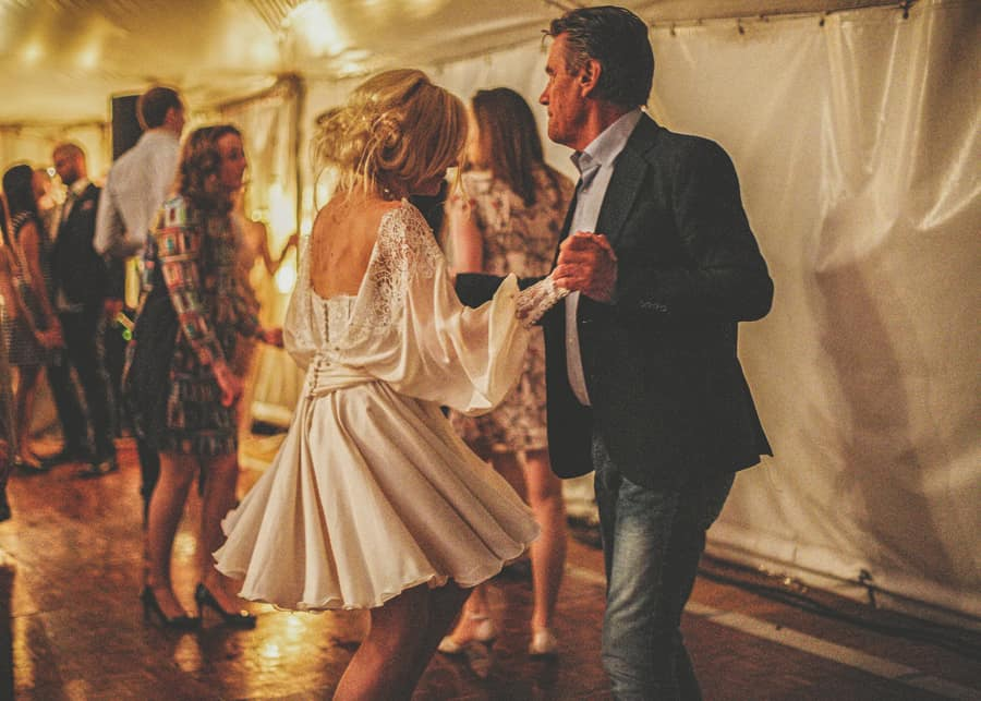The bride dances with her father in the marquee at Sharpham Park