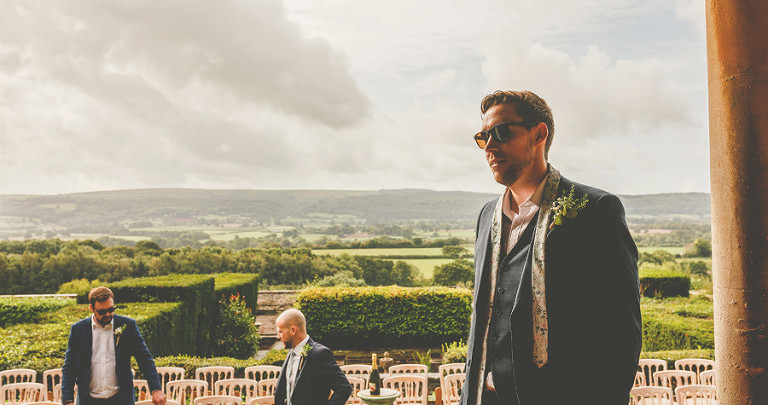 The groom and his ushers in the gardens at Barley Wood house, Bristol