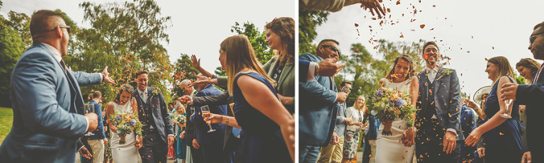 The couple walk towards Barley Wood house as wedding guests throw confetti