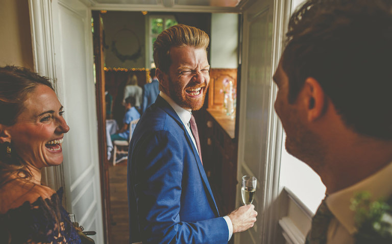 Wedding guests arriving to eat at Barley Wood house, Bristol