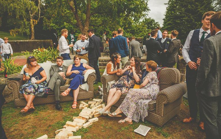 Wedding guests sit on the sofa at Barley Wood house, Bristol