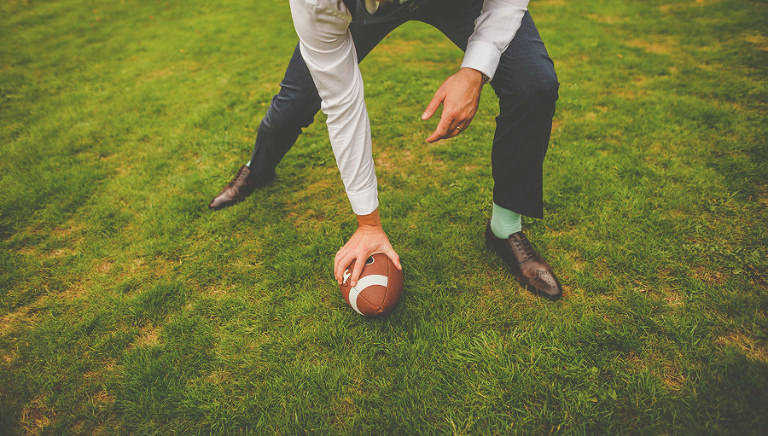 The groom picks up the football