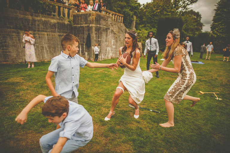 The bride playing rugby at Barley Wood house, Bristol
