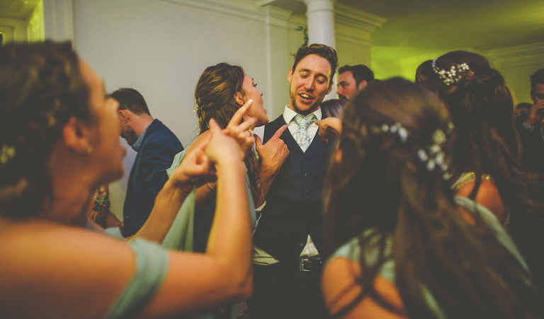 The groom sings and dances with his family on the dancefloor at Barley Wood house, Bristol