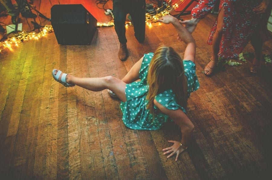 A lady falls on the dancefloor