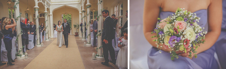 The bride and her brother walk down the aisle in the orangery at St. Audries Park