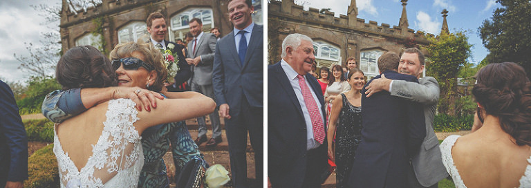 Wedding guests congratulate the bride and groom outside the orangery in St. Audries Park
