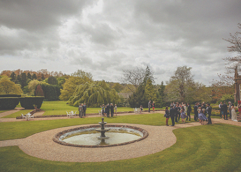 The wedding party stand on the lawn at St. Audries Park