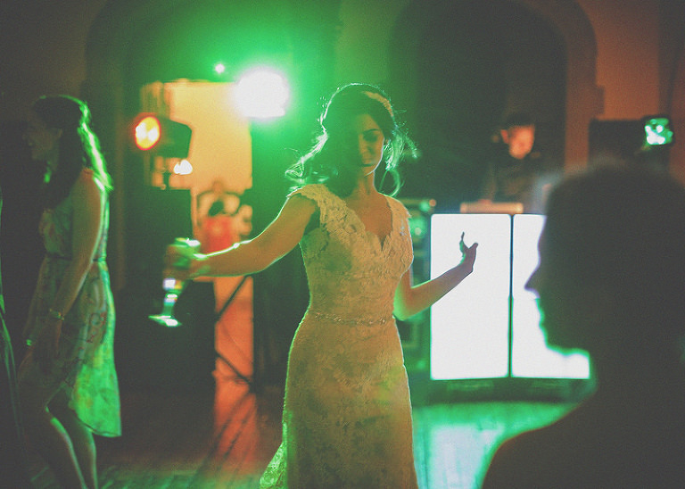 The bride dances with friends and family on the dancefloor