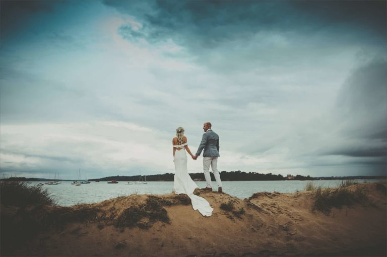 The bride and Groom looking out to Brownsea Island