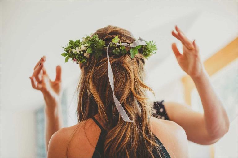 Bridesmaids adjusting the flower hats