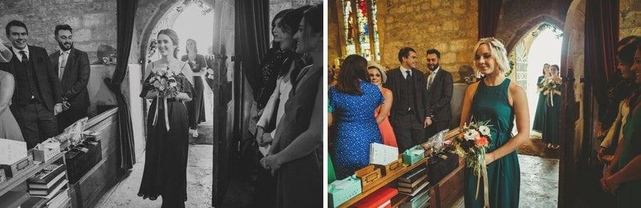 The bridesmaids walk into the church