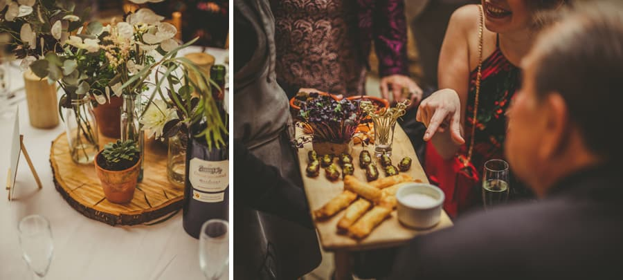 A lady points at a food platter and the wedding table at the Tithe Barn in Symondsbury