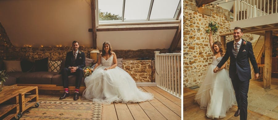 The bride and groom walk into the Tithe Barn in Symondsbury
