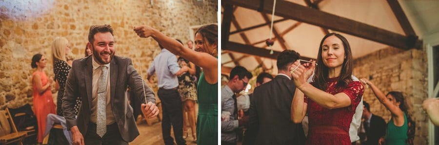 Wedding guests playing conkers in the barn