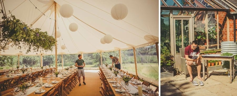 Wedding guests prepare the wedding dinner table in the marquee at Mill farm