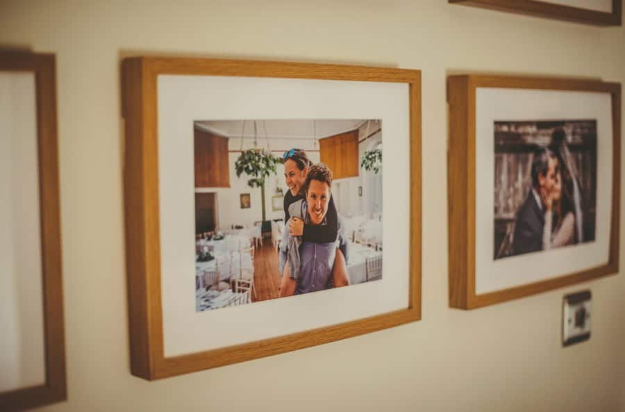 A framed photograph of the bride and groom hangs in the hallway at Mill farm