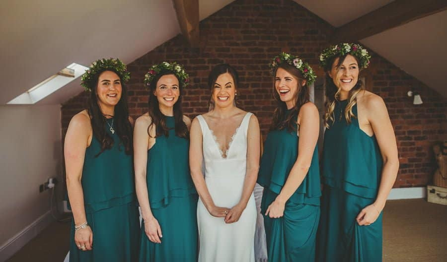 The bride and the bridesmaids pose for a photograph