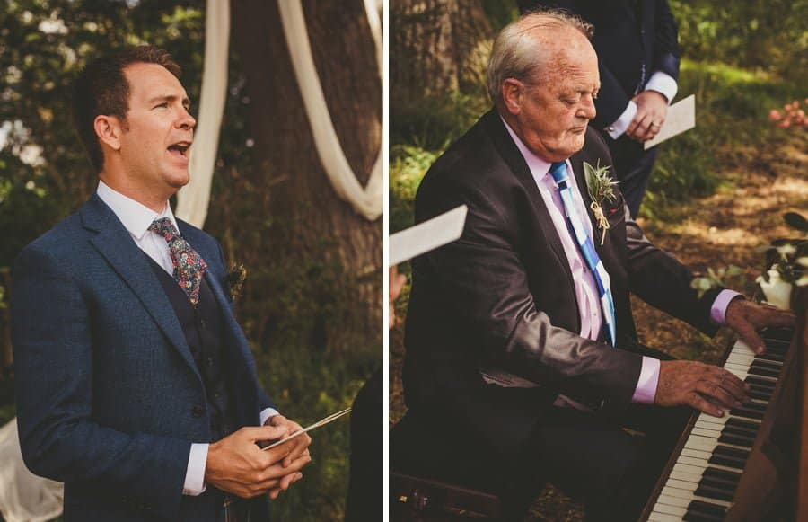 A wedding guest sings and the brides father plays a piano during the outdoor ceremony