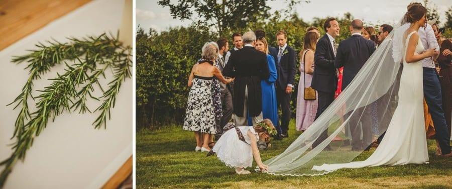 A flowergirl straightens the brides dress
