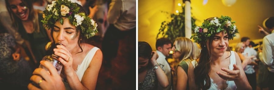The bride drinks a bottle of whisky on the dancefloor